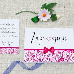 ślubne zaproszenie z elegancką kokardką